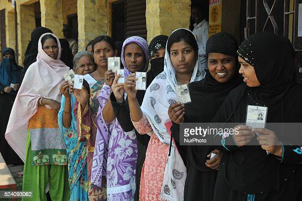 Indian voters wait to cast their ballots in the state assembly elections at a polling station in Kamarhati on the outskirts of Kolkata on April 25...