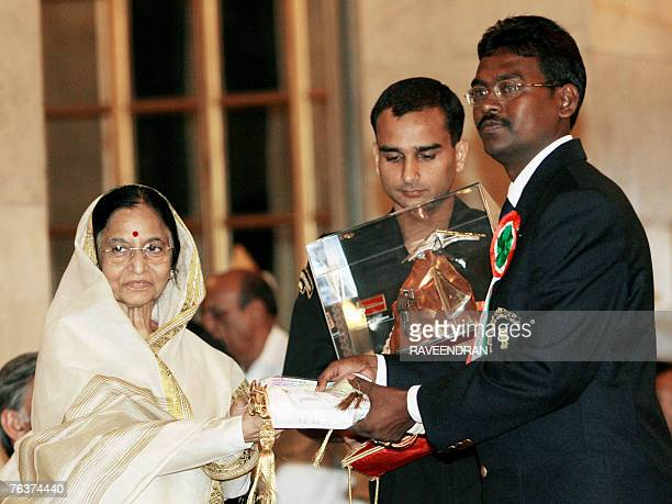 Indian water adventurer Tapas Chowdhury receives The Tenzing Norgay National Adventure Awards 2006 from Indian President Pratiba Patil during a...