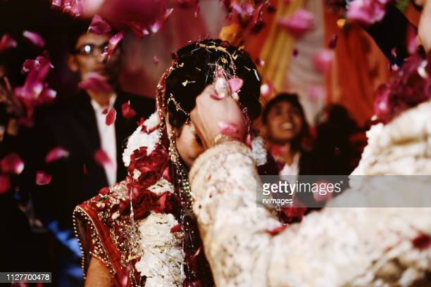 indian wedding ceremony, garland or jai mala ceremony - indian culture stock pictures, royalty-free photos & images