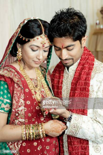 Indian Wedding Couple Looking at Rings