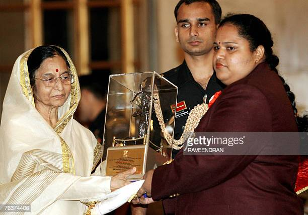 Indian Weightlfing champion and Gold medal winner of the Melbourne Commonwelath Weightlifting Championships 2005 Geeta Rani receives the Arjuna Award...