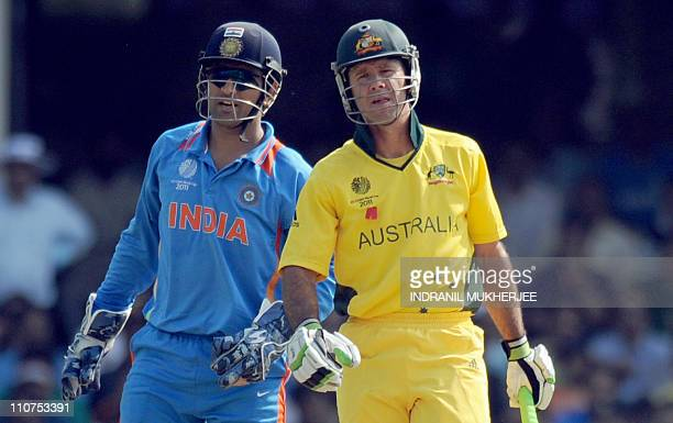 Indian wicketkeeper and captain Mahendra Singh Dhoni and Australian batsman and team captain Ricky Ponting watch during the quarterfinal match of The...