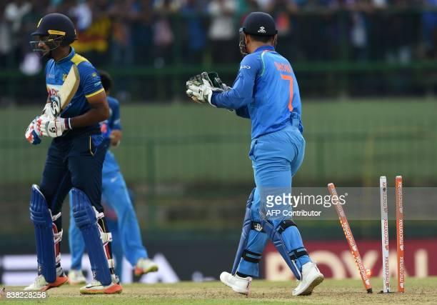Indian wicketkeeper Mahendra Singh Dhoni dismisses Sri Lankan cricketer Danushka Gunathilaka during the second one day international cricket match...