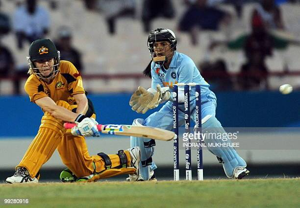 Indian wicketkeeper Sulakshana Naik looks on as Australian cricketer Jess Cameron plays a shot during the ICC Women�s World Cup Twenty20 semi final...