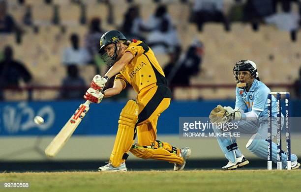 Indian wicketkeeper Sulakshana Naik looks on as Australian Leah Poulton plays a shot during the ICC Women�s World Cup Twenty20 semi final match...