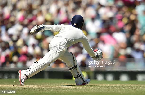 Indian wicketkeeper Wriddhiman Saha catches the ball to dismiss Australian captain Steven Smith during day two of the fourth cricket Test between...