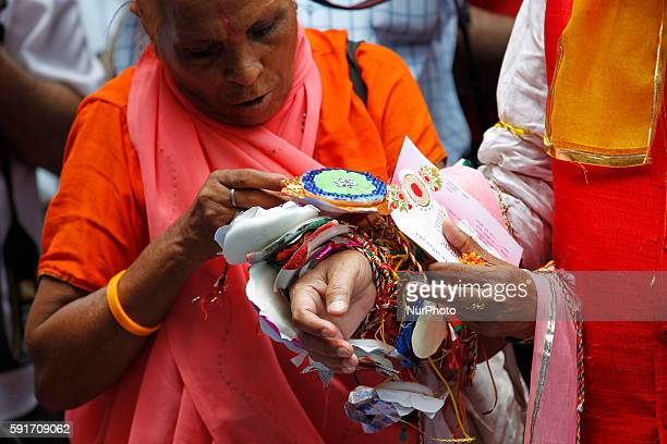 Indian Widow tie Rakhi around the wrist of the founder of the NGO Sulabh International chairman Bindeshwari Pathak on the eve of the Raksha Bandhan...