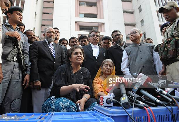 Indian widow Zakia Jafri listens as activist Teesta Setalvad addresses media representatives outside a court in Ahmedabad on December 26 following a...