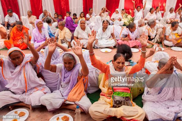 Indian widows gather for a meal before the start of the remarriage of Vinita Devi a former widow at Gopinath temple in the Vrindavan on October 16...