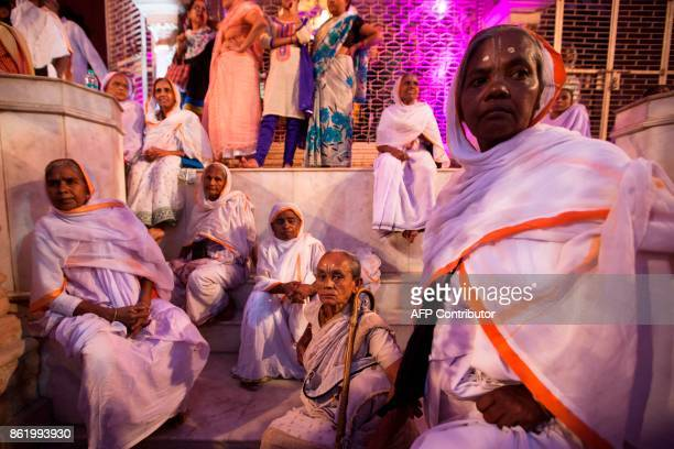 Indian widows rest after the wedding ceremony of Vinita Devi a former widow and Rakesh Kumar at Gopinath temple in the Vrindavan on October 16 2017...