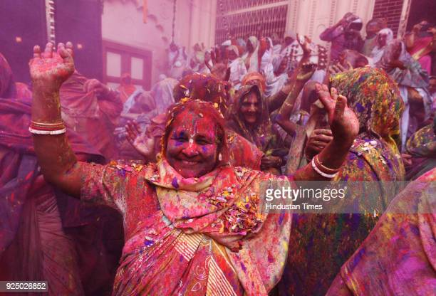 Indian widows take part in Holi celebration organized by Sulabh International at Gopinath Temple on February 27 2018 in Vrindavan India The widows of...