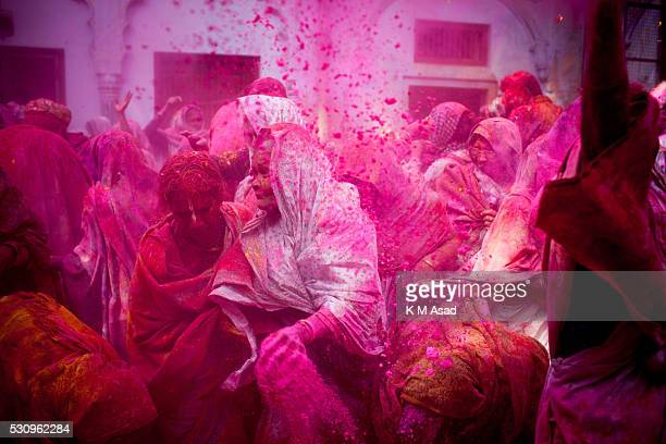 Indian widows takes part in celebrate Holi or 'festival of colors' at the Meerasahabhagini Ashram in Vrindavan India March 03 2015 Widows congregated...