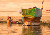 traditional indian woman living boat washing