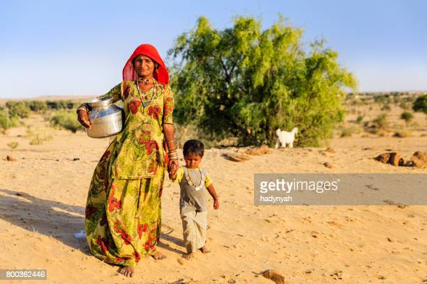 indian woman carrying water from the well, rajasthan - drought stock pictures, royalty-free photos & images