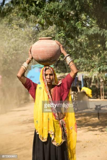 Indian woman carrying water pot