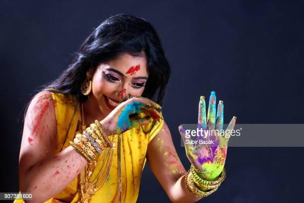 Indian woman celebrating and enjoying  Holi.