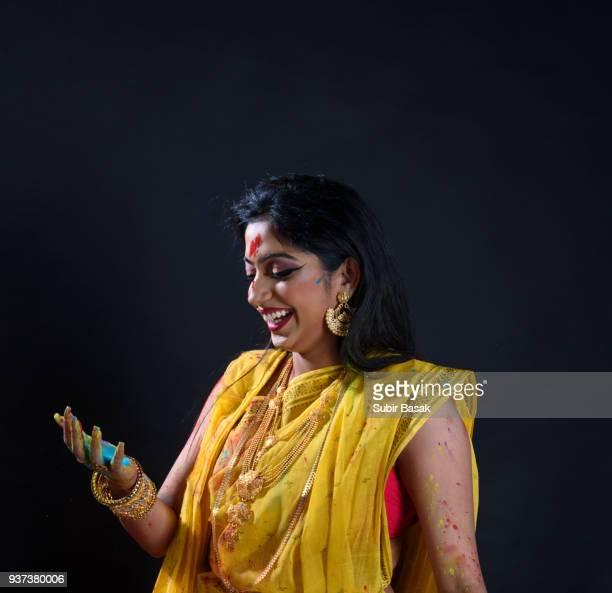 Indian woman celebrating Holi festival.