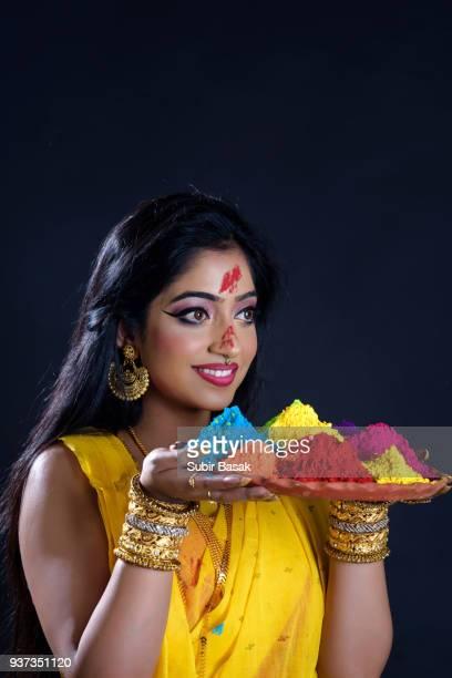 Indian woman celebrating Holi.