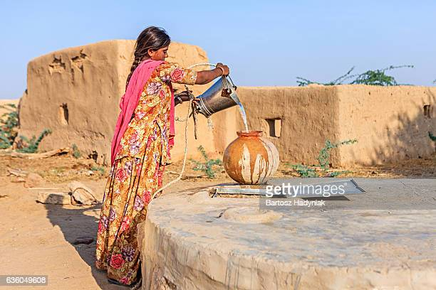 Indian woman collecting water, Rajasthan