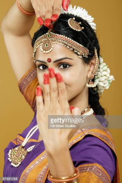 Indian woman dancing in traditional dress