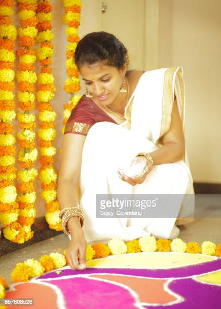 Indian Woman Decorating the Floor