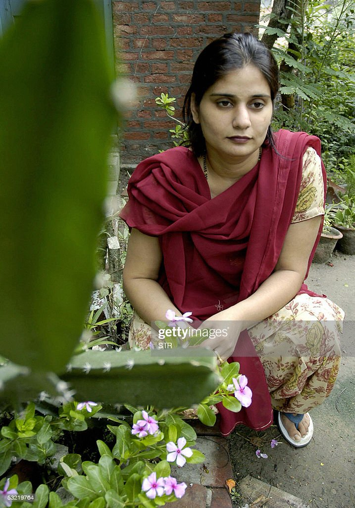 Indian woman Dimple Menezes poses in the garden of her home at Tam