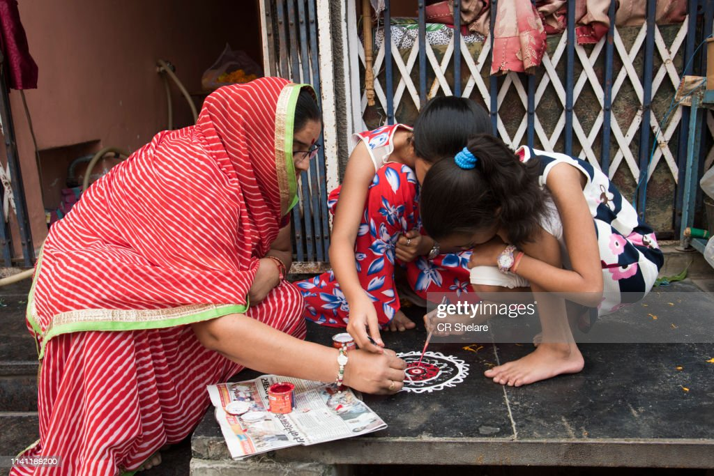 Indian Woman draw Rangoli. : Stock Photo