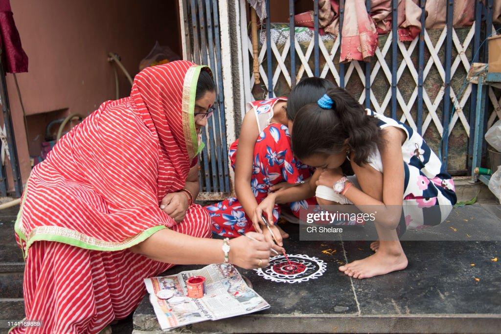 Indian Woman draw Rangoli. : Stock Photo