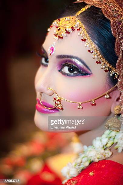 indian woman dressed for her wedding - bangladeshi bride stock photos and pictures