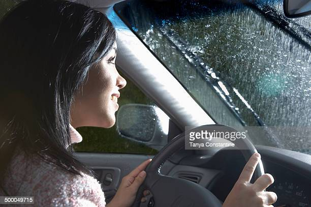 Indian woman driving in heavy rain