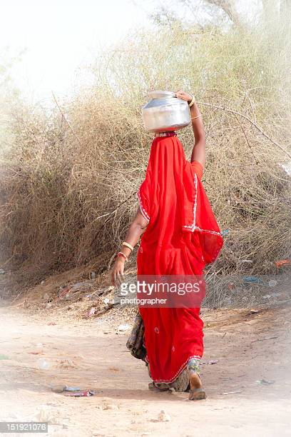 Indian woman gathers water