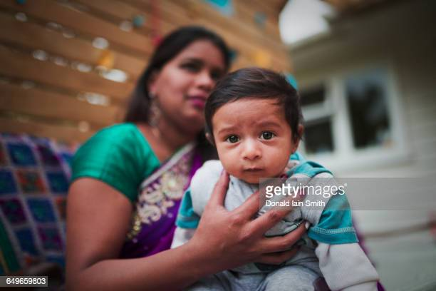 Indian woman holding baby son