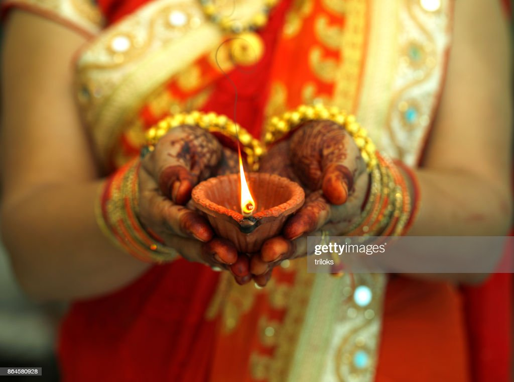 Indian woman holding Diwali oil lamp : Stock Photo