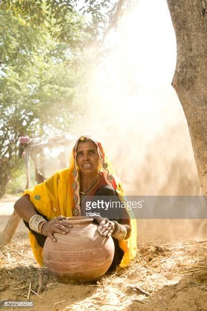 Indian woman holding earthen pot
