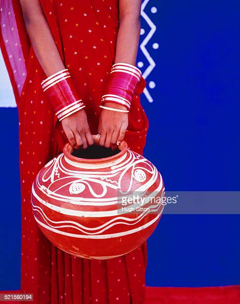 indian woman holding water pot - hugh sitton stock pictures, royalty-free photos & images