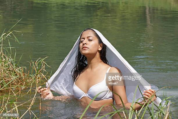 indian woman in a white sari - bra stock pictures, royalty-free photos & images