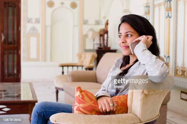 Indian woman in hotel lobby making a phone call