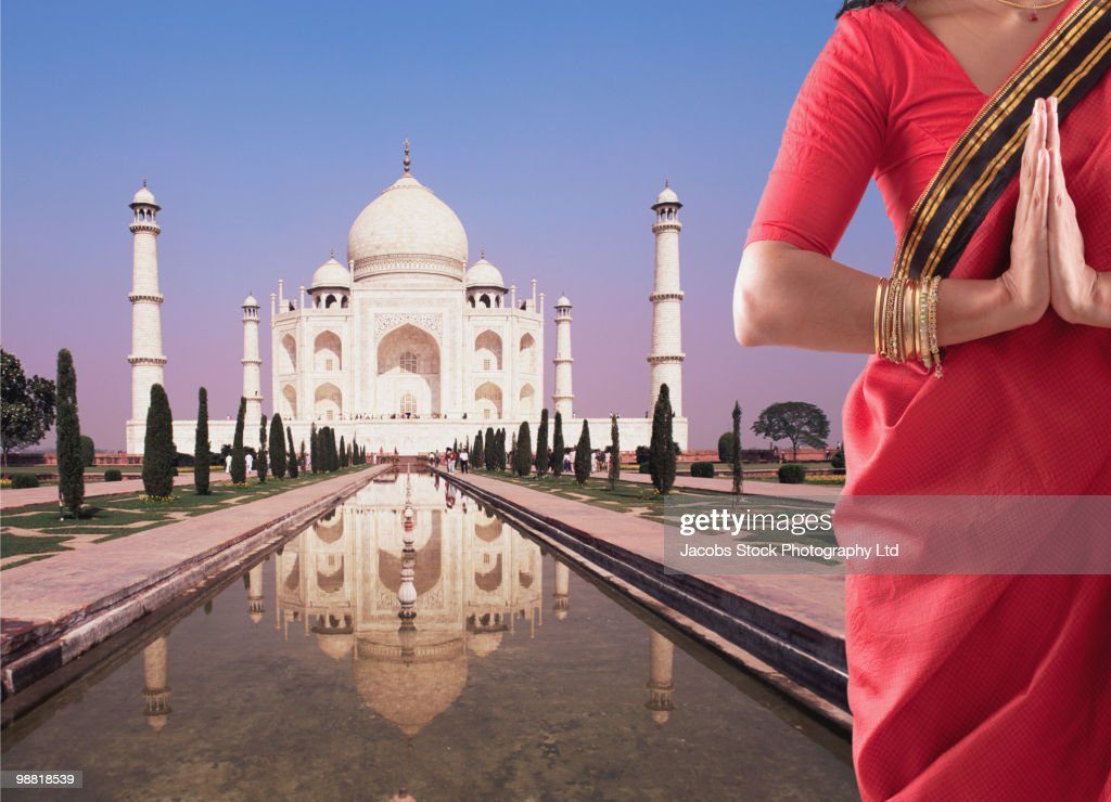 Indian woman in traditional clothing near the Taj Mahal : Stock Photo