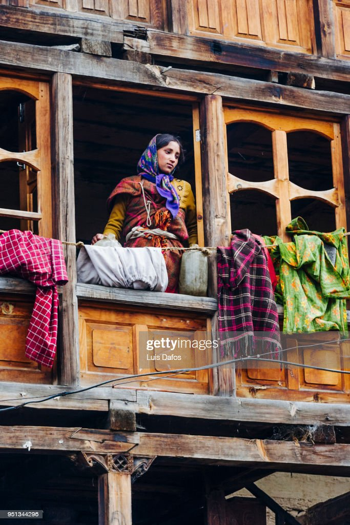 Indian woman in traditional wooden house : Stock Photo