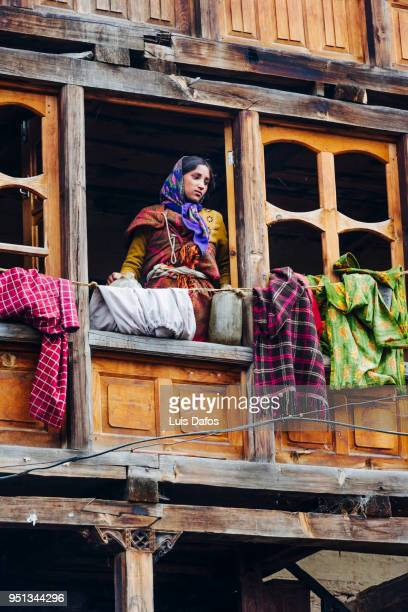 indian woman in traditional wooden house - dafos stock photos and pictures