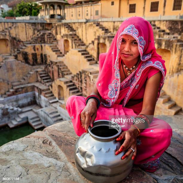 indian woman in village near jaipur, india - stepwell stock pictures, royalty-free photos & images
