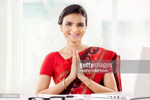 Indian woman in welcome namaste hello greeting pose stock photo indian woman in welcome namaste hello greeting pose stock photo getty images m4hsunfo