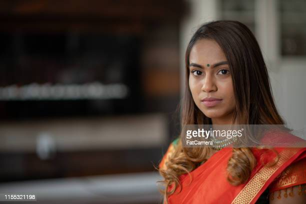 indian woman looking semi-serious in traditional clothing - bindi stock pictures, royalty-free photos & images