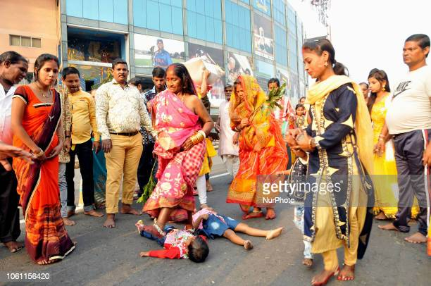 Indian woman lying prostrate worshiping the Sun god during Chhat puja on a road in Kolkata before going to the Hooghly river Chhath is an ancient...