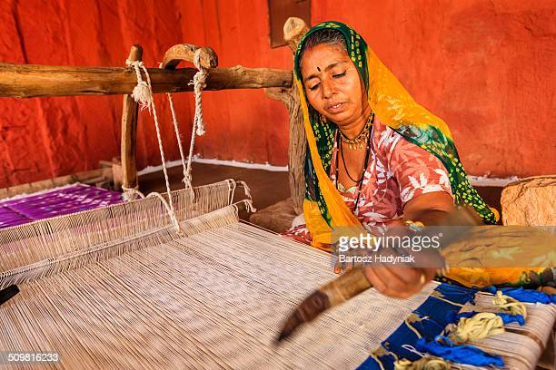 Indian woman making dhurry - colorful carpet