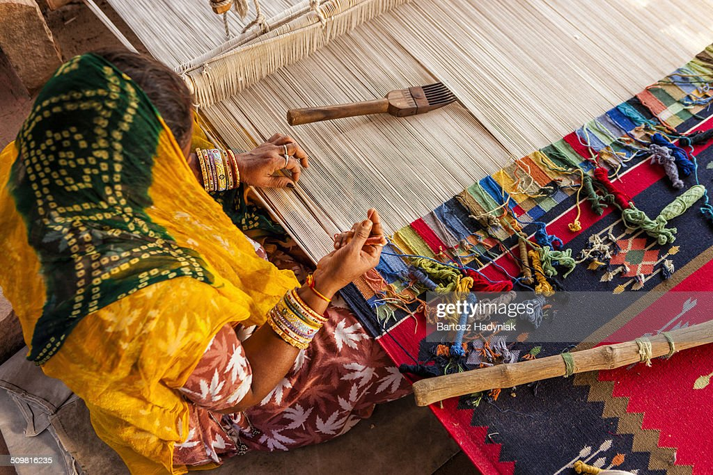 Indian woman making dhurry - colorful carpet : Stock Photo
