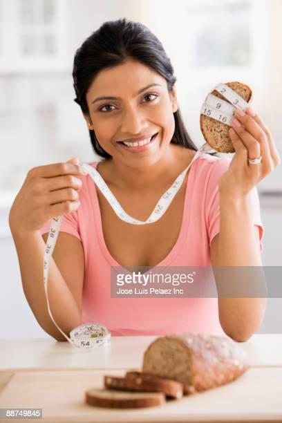 Indian woman measuring bread