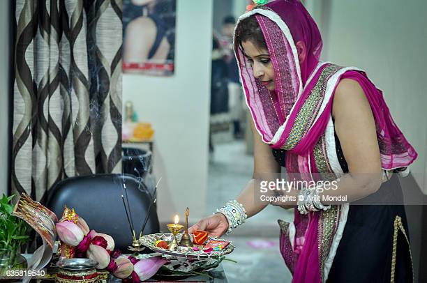 indian woman offering diwali puja at shop in india - diya oil lamp stock pictures, royalty-free photos & images