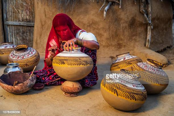 indian woman painting vases in her workshop, rajasthan, india - craft product stock pictures, royalty-free photos & images