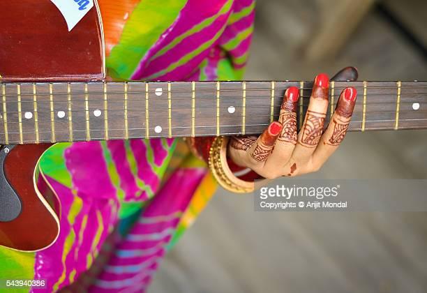 Indian woman playing guitar with sari